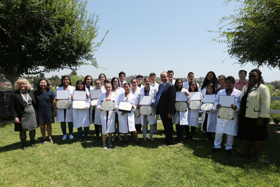 Group of students holding their Grifols certificates.